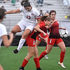 (Brad Davis/The Register-Herald) University's Braden Pickett, left, ends up on Cabell Midland player Abigail Long's back after just missing a header sent her way during the Class AAA Girls State Soccer Championship Game Saturday afternoon at the YMCA Paul Cline Memorial Sports Complex.