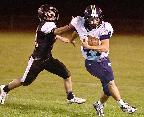 (Brad Davis/The Register-Herald) Nicholas County's D.J. McCutcheon avoids PikeView defender Brian Keen as he rumbles for a big gain Friday night in Gardner.