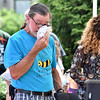 (Brad Davis/The Register-Herald) Ronnie Scott, who lost his wife Belinda in the flood, is just one of many to get emotional during a somber dedication ceremony for the Old Mill Park Memorial Friday afternoon in White Sulphur Springs.