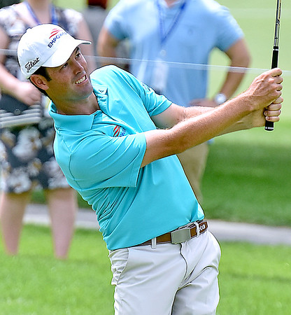 (Brad Davis/The Register-Herald) Robert Streb shoots from the #10 fairway during third round Greenbrier Classic action Saturday afternoon in White Sulphur Springs.
