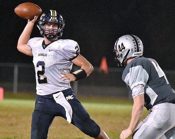 (Brad Davis/The Register-Herald) Nicholas County quarterback Jared Sagraves throws as he's persued by Westside defender Ethan Stewart Friday night in Clear Fork.