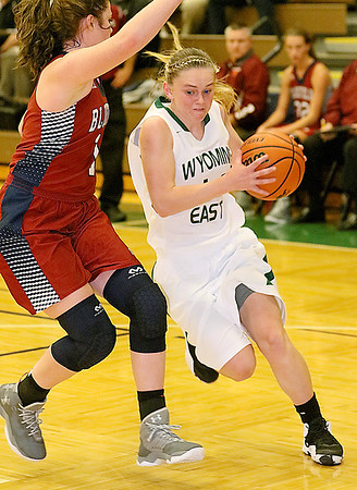 (Brad Davis/The Register-Herald) Wyoming East's Jasmine Blankenship drives to the basket as Bluefield's Autumn Spangler defends Wednesday night in New Richmond.