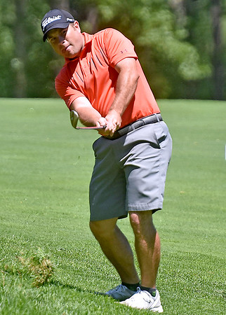 (Brad Davis/The Register-Herald) Chad Griffith shoots from a fairway during BNI action Sunday afternoon at Glade Springs' Stonehaven Golf Course.