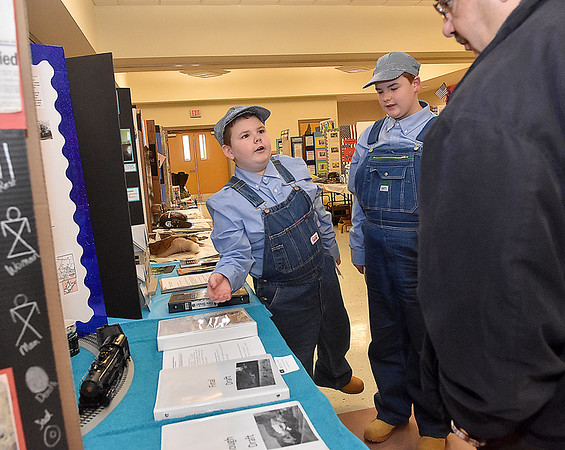 (Brad Davis/The Register-Herald) Iaeger (McDowell County) Elementary students Adyn Lockhart (pointing) and his brother Adam present their project on the Cass Scenic Railroad to judges Sam Interdonato and David Stewart (not photographed) during the R.E.S.A. 1 Regional Social Studies Fair Saturday morning at the Beckley-Raleigh County Convention Center. Students from Monroe, McDowell, Raleigh, Summers and Wyoming Counties presented 191 projects with awards going out in nine different categories over three grade divisions (3rd-5th, 6th-8th and 9th-12th).