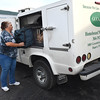 Lisa Vandall looks helps load up the truck with lunches at the Greenbrier County Committee on Aging in Rupert.<br /> (Rick Barbero/The Register-Herald)