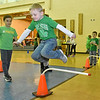 (Brad Davis/The Register-Herald) Kindergartener Carson Coffman clears another obstacle as he jumps away some extra energy during Maxwell Hill Elementary's Jumping for Hearts event Friday afternoon in the school's gymnasium. Students spent several days gathering donations for the American Heart Association by sending out e-mails, asking friends and family or even going door-to-door in their neighborhoods if they wised, raising around $5,000 overall. The annual event concluded with a special celebration in the gym where students got to run and play in a variety of jumping-related activities.