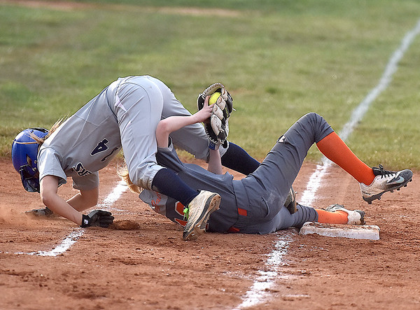 (Brad Davis/The Register-Herald) Richwood 3rd baseman Kayley Twiddy makes a skillful catch and tag to get out Shady Spring's Mandy Showalter, but pays a price as she takes spikes to the right leg in the process during the Tigers' win over the Lady Jacks Wednesday evening in Shady Spring. Twiddy was bloodied and shaken for a moment after the play but would stay in the game.