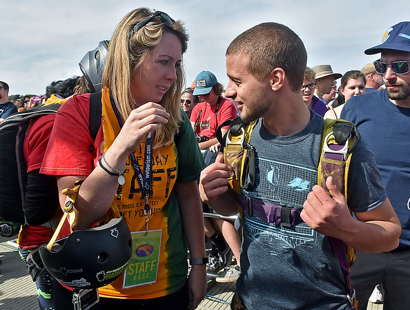 (Brad Davis/The Register-Herald) B.A.S.E. jumper and Bridge Day worker Max Riggs, right, talks with girlfriend Ellen Cochran in the platform area before making his first jump of the day Saturday afternoon.
