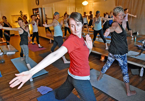 (Brad Davis/The Register-Herald) Attendees participate in a class at Balanced Life Yoga September 8.