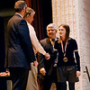 Reagan Lilly, a freshman at Woodrow Wilson High School, shakes hands with Larry Ford, a board member with Raleigh County Schools, as Raleigh County Schools Superintendent David Price, right, and Randy Adkins, left, also with Raleigh County Schools, look on as she is awarded First Place in the Environmental Science Category as part of the Raleigh County Science Fair Saturday at Woodrow Wilson. Lilly won first place with her project on trihalomethanes. (Chris Jackson/The Register-Herald)