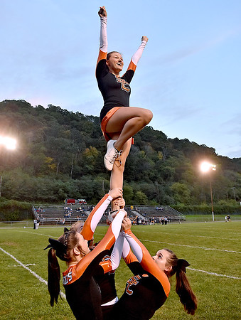 (Brad Davis/The Register-Herald) Summers County cheerleader Krystina Gore is hoisted up by teammates (from left) Karsyn Keaton, Haleigh Cozort and Jordan Rutherford Friday night in Hinton.