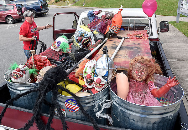 (Brad Davis/The Register-Herald) Scott Hill, General Manager for Theatre West Virginia, exits his prop-filled truck Thursday as he arrives at the Exhibition Coal Mine for meetings with actors and setup for the Beckley Haunted Coal Mine, which opens up this evening at 6:00 p.m.