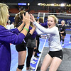 (Brad Davis/The Register-Herald) James Monroeplayers get fired up prior to their afternoon match against Robert C. Byrd during State Volleyball Tournament action Friday at the Charleston Civic Center.