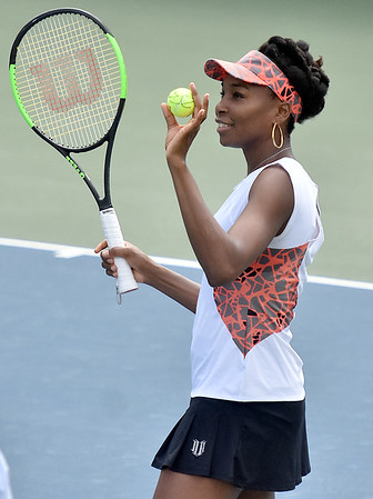 (Brad Davis/The Register-Herald) All-time tennis great Venus Williams prepares to hit an autographed ball into the crowd following her match against Martina Hingis during the Greenbrier Champions Tennis Classic Saturday afternoon in White Sulphur Springs.
