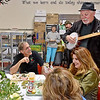 """(Brad Davis/The Register-Herald) Richwood mayor Bob Henry Baber, left, and company are treated to  a special ramp-themed song from local musician John """"The Appalachian"""" Wyatt during the annual Feast of the Ramson Saturday afternoon at Cherry River Elementary School."""