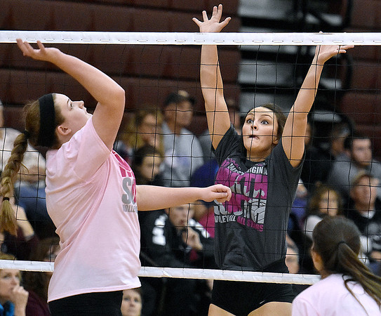 (Brad Davis/The Register-Herald) Greenbrier East's Maddie Cochran rushes in to try and block an incoming spike as her Class AAA (grey) All-Stars take on a squad of Class AA (pink) All-Stars during the West Virginia North/South All-Star Volleyball event Saturday afternoon at Woodrow Wilson High School.