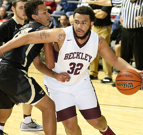 (Brad Davis/The Register-Herald) Woodrow Wilson's Tarek Payne rumbles to the basket as University's Storm Leftridge defends during Big Atlantic Classic action Saturday night at the Beckley-Raleigh County Convention Center.