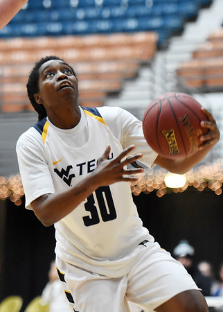 WVU Tech's Zjhane West (30) goes up for a layup dduring the third quarter of their college basketball game Tuesday in Beckley. (Chris Jackson/The Register-Herald)