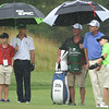 Davis Love III, 4th form left, watches Alex Kagen, of Lewisburg, hit his shot on the 11th hole during the First Tee Greenbrier Classic Scramble held on the Old White course at The Greenbrier.<br /> (Rick Barbero/The Register-herald)