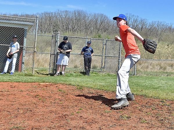 (Brad Davis/The Register-Herald) Baseball player Evan Sinclair takes his turn fielding ground balls as his Shady Sharks junior little league teammates watch during a practice Sunday afternoon at the Beckley Little League fields.