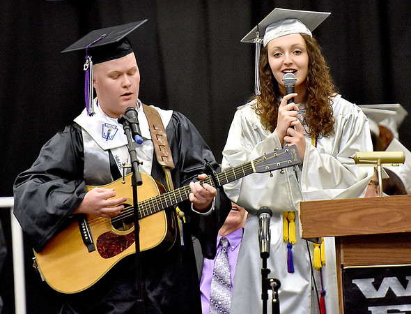 "(Brad Davis/The Register-Herald) Westside seniors Jordan Cook and Michaela Shumate perform ""Country Roads"" during the school's 2017 Commencement Sunday afternoon in Clear Fork."