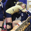 (Brad Davis/The Register-Herald) Shady Spring's Brooklyn Cook (#11) is consoled by teammate  Madison Lilly following the Tigers' loss against Bridgeport during State Volleyball Tournament action Friday morning at the Charleston Civic Center. Cook was forced to leave the match after suffering an ankle injury.