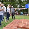 (Brad Davis/The Register-Herald) Attendees browse a brick memorial during the annual Lilly Family Reunion Saturday afternoon near Ghent.