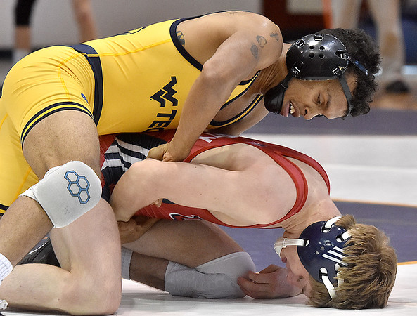(Brad Davis/The Register-Herald) WVU Tech's Paul Gonzales takes on Liberty University's Keegan Smith in a 125-pound weight class matchup during a tri-match Saturday afternoon in Beckley. Gonzales would win the match.