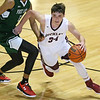 (Brad Davis/The Register-Herald) Woodrow Wilson's Bryce Radford cuts around First Love Christian's Dylan Morrison defends during the championship game of the Battle for the Armory Basketball Tournament Friday night at the Beckley-Raleigh County Convention Center.