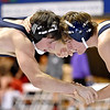 (Brad Davis/The Register-Herald) Greenbrier West's Chase Patterson, left, takes on Moeller's Vince Scally in a 152-pound weight class matchup during the West Virginia Army National Guard Duals Friday afternoon at the Beckley-Raleigh County Convention Center. West's Patterson would win the match.