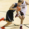 (Brad Davis/The Register-Herald) Princeton's Cole Cochran moves the ball up the court as Woodrow Wilson's Eddie Christian defends during Big Atlantic Classic action Friday night at the Beckley-Raleigh County Convention Center.