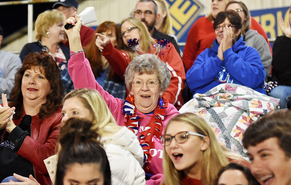 A Midland Trail fan reacts to the opening of their game against Nicholas County Friday in Summersville. (Chris Jackson/The Register-Herald)