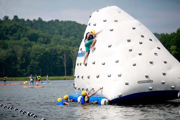 Scouts compete in a four-man team obstacle course at Tridave Lake during the 2017 National Jamboree at The Summit Bechtel Reserve near Mt. Hope. (Chris Jackson/The Register-Herald)