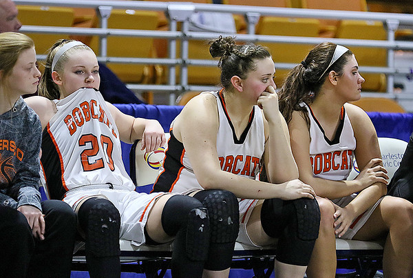 (Brad Davis/The Register-Herald) Summers County players (from left) Tiffani Cline, Erica Merrill and senior Morgan Miller watch as events on the court turn against the Lady Bobcats in a tough loss to St. Joseph Central that ended their state tournament run and season Friday afternoon in Charleston.