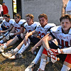(Brad Davis/The Register-Herald) Indy football players take a few minutes for a quick rest outside of the visitors' locker room following warmups prior to their road game at Summers County Friday night in Hinton.