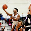 Woodrow Wilson's Isaiah Francis goes up for a layup over Riverside's (11) and (20) during their game Wednesday in Beckley. (Chris Jackson/The Register-Herald)