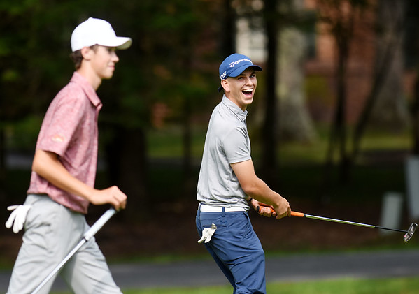 Landon Perry jokes with Jackson Hill on the No. 12 hole during the championship round of the annual BNI Tournament Monday at The Resort at Glade Springs. (Chris Jackson/The Register-Herald)