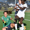 (Brad Davis/The Register-Herald) Spring Valley goalkeep Kim Holland slides to break up the play as Woodrow Wilson's Mikah Alleyne crashes the net to create a scoring chance Thursday evening at the YMCA Paul Cline Memorial Sports Complex.