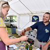 (Brad Davis/The Register-Herald) Daniel Vineyards' Rich Daniel pours a sample for Sarah Houck during Spring Wine Fest Saturday.