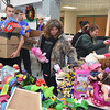 (Brad Davis/The Register-Herald) Volunteers lug the boxes while shoppers fill them with toys during the Wyoming County Toy Fund Sunday morning at Wyoming East High School.
