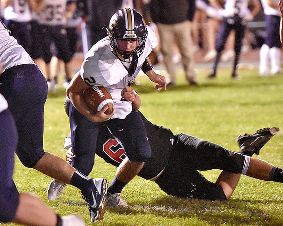 (Brad Davis/The Register-Herald) Nicholas County quarterback Jared Sagraves keeps the ball as he's caught by PikeView defender Matthew Damewood Friday night in Gardner.