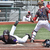 (Brad Davis/The Register-Herald) James Monroe's William Shiflet dives in to score a run before Independence catcher Haegan Harvey can turn to make the tag during the first of two games Friday afternoon at Linda K. Epling Stadium.