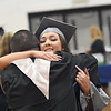 Valley High School senior Madison Jones gets a hug from Principal Craig Loy during the Class of 2017 Valley High Commencement Saturday in Smithers. (Chris Jackson/The Register-Herald)