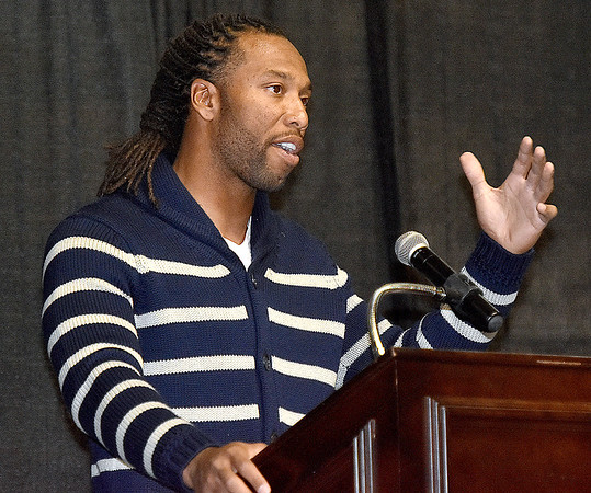 (Brad Davis/The Register-Herald) Arizona Cardinals receiver Larry Fitzgerald delivers a speech as the keynote speaker of the Big Atlantic Classic Tip-Off Banquet Sunday afternoon at the Beckley-Raleigh County Convention Center.