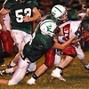 Casey Wood of Oak Hill is dragged down by a pair of Fayetteville defenders.