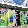 (Brad Davis/The Register-Herald) The windows of National TV & Appliance are ablaze with ads for a liquidation sale while shoppers hold the door for fellow shoppers Kelia Goff and her 2-year-old daughter Riley, right, as they enter the 1412 North Eisenhower Drive store Thursday afternoon.