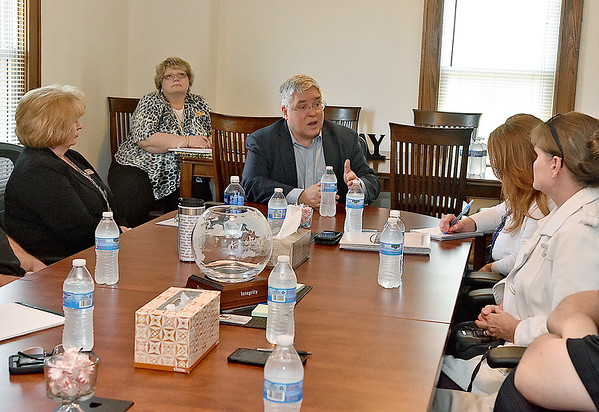 (Brad Davis/The Register-Herald) Attorney General Patrick Morrisey participates in a roundtable discussion on addiction and sunstance abuse with local leaders at the One Voice office on Kanawha Street Friday afternoon.