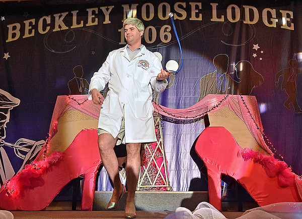 (Brad Davis/The Register-Herald) Dr. John Fernald during the annual event Hunks in Heels fundraising event for the Women's Resource Center Friday night at the Beckley Moose Lodge.