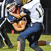 (Brad Davis/The Register-Herald) Independence's Connor Gibson is caught and tackled in the backfield by Shady Spring's Kole Monette Friday night in Coal City.