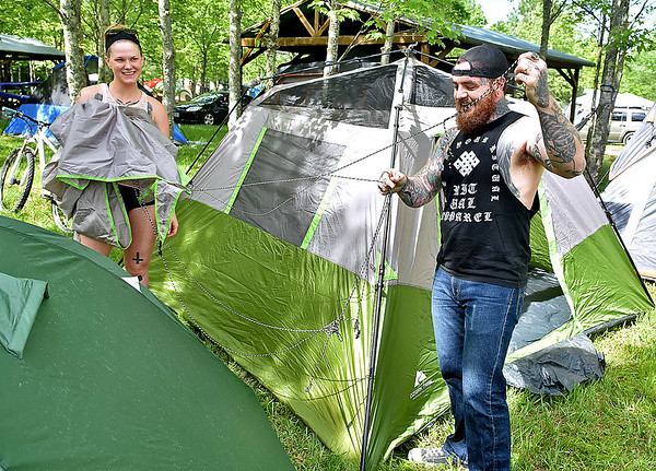 (Brad Davis/The Register-Herald) Huntington residents Becca Casto and Nate Holley try to untangle the strings on their rain fly as they set up camp on the first day of this year's Mountain Music Festival at Ace Adventure Resort Thursday afternoon in Minden.